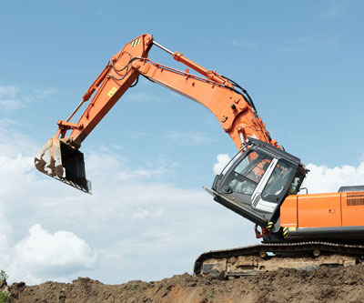 Excavator titling up mining