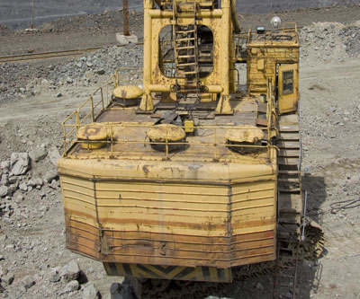 Excavator on the the iron ore opencast mining site