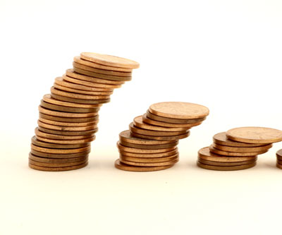 stacked gold coins financing mining