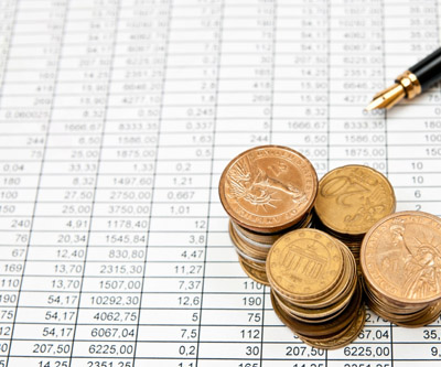 Gold coins pen and charts mining