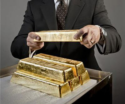 Gold price drops below $1,600