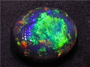Polished Australian black opal