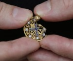 Snakes hunter finds enigmatic gold, diamond, sapphire pendant