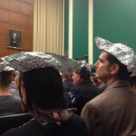 Environmentalists sport tin hats for subcommittee hearing on climate change