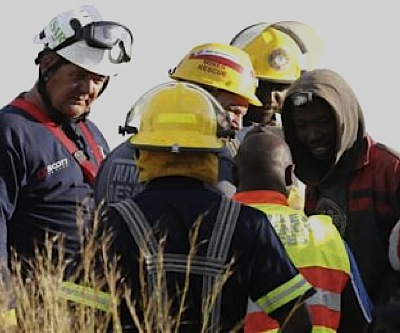 Twelve of dozens illegal miners trapped in a South African mine rescued and arrested