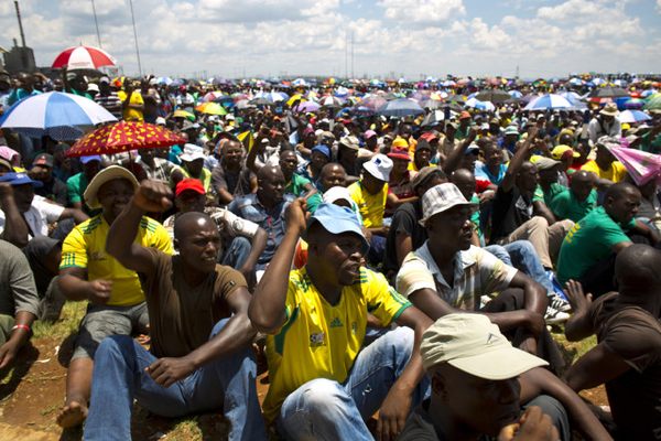 South African platinum miners review wage demands, will march in Pretoria as strike, talks, go on