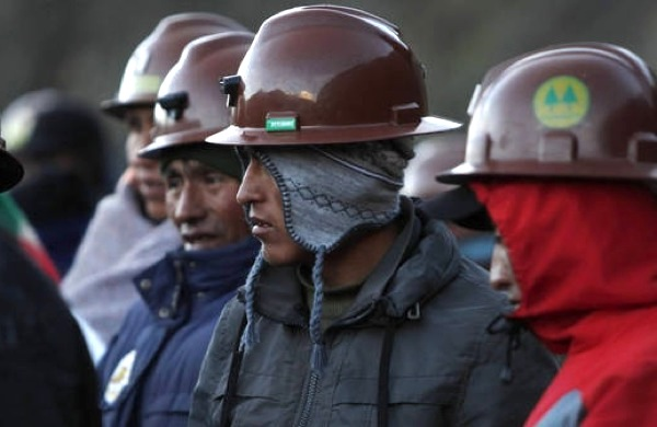 Bolivia's government sides with workers in conflict with bosses in