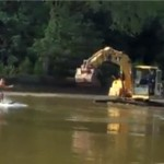 VIDEO: Water skiing with an excavator