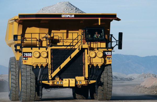 Commodity prices hit Caterpillar profit — down 25%