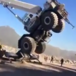 VIDEO: Haul truck crane is up-ended