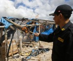 Peruvian police burns down entire illegal gold mine town