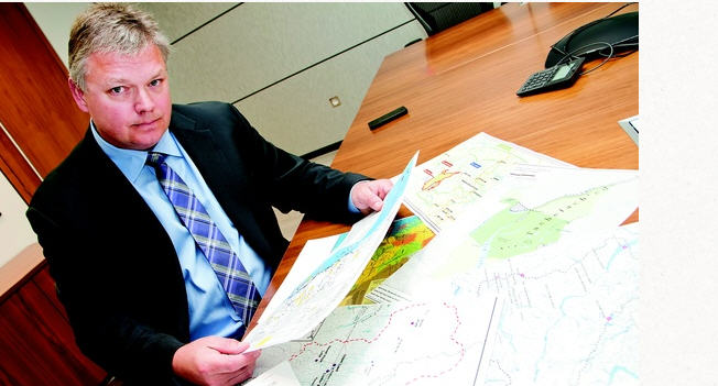 McMillian LLP Lawyer Robin Junger, who specializes in aboriginal land claims, sorting through maps in his Vancouver Office l Chung Chow