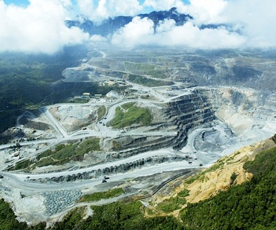 Pacific Battle Over Gold Mine Ends With Barrick Stake Deal
