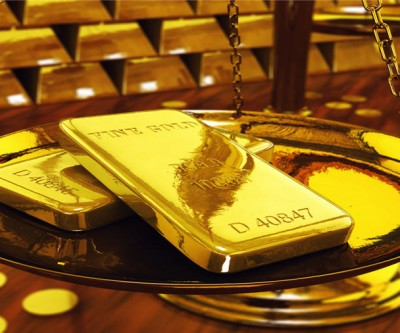 Gold prices hit by profit taking, stronger dollar