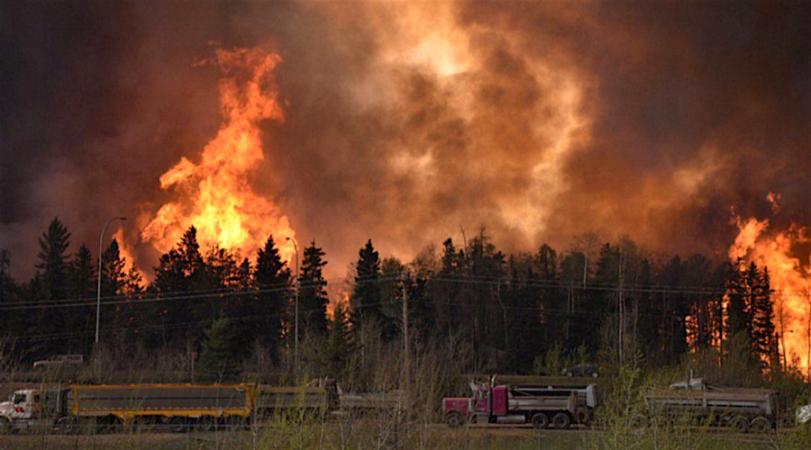 Canada's oil sands cuts production as wildfire forces mass evacuation