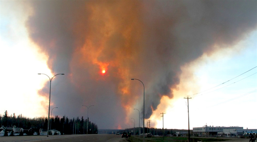 A wildfire forced a state of emergency and evacuation in Fort McMurray. The fires also shut down several oil sands operations close by.