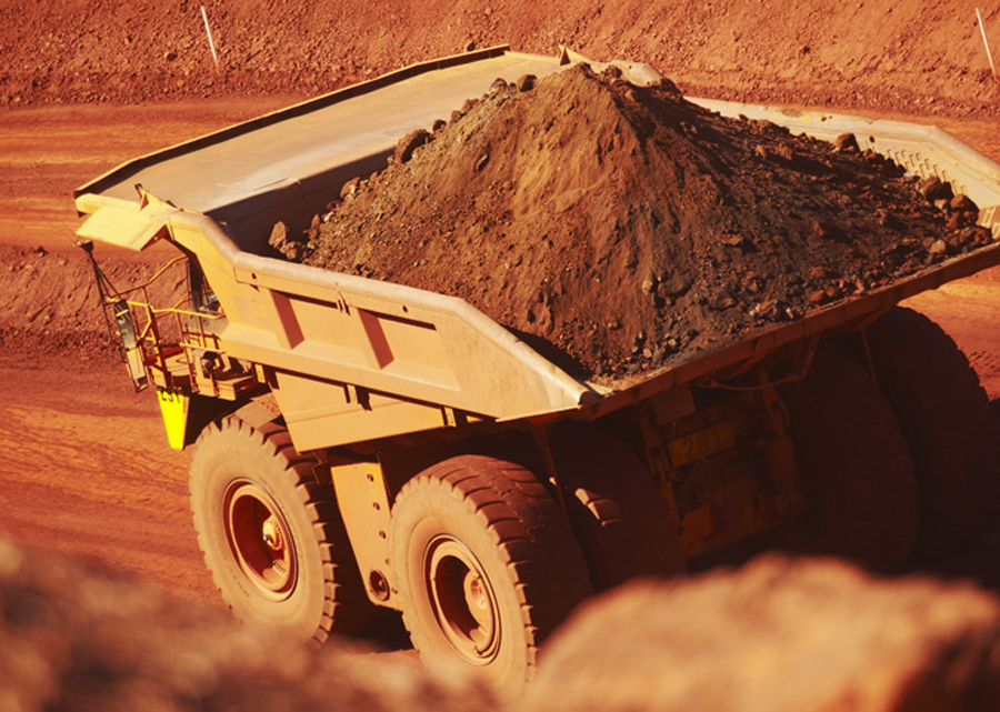 BHP hits record iron ore output but warns of risks from virus