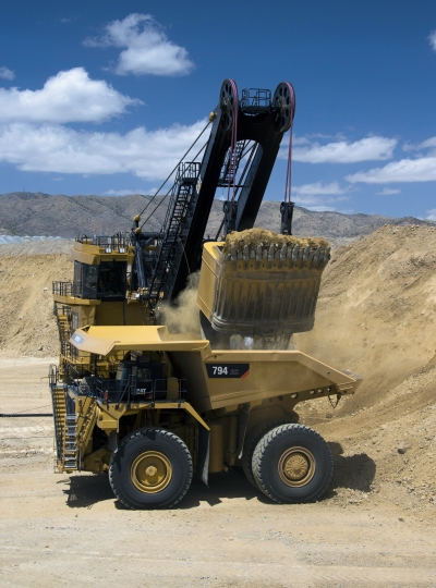 Cat 794 AC truck being loaded by Cat 7495 shovel