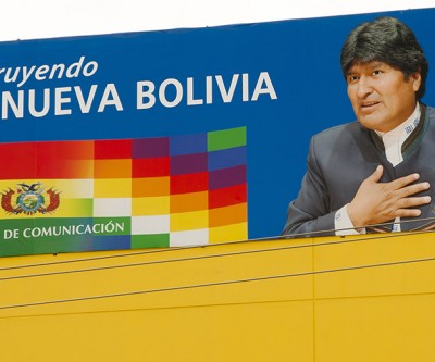 """President Evo Morales on a presidential poster, with a slogan that says """"building the new Bolivia"""""""