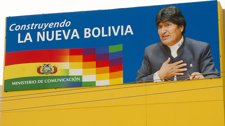 "President Evo Morales on a presidential poster, with a slogan that says ""building the new Bolivia"""
