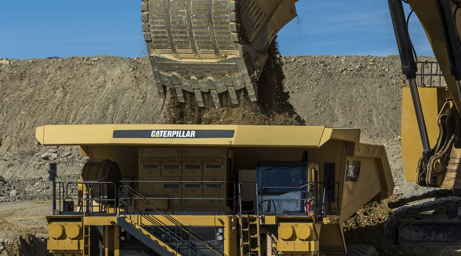 cat-794-ac-truck-being-loaded-by-cat-6060-hydraulic-shovel