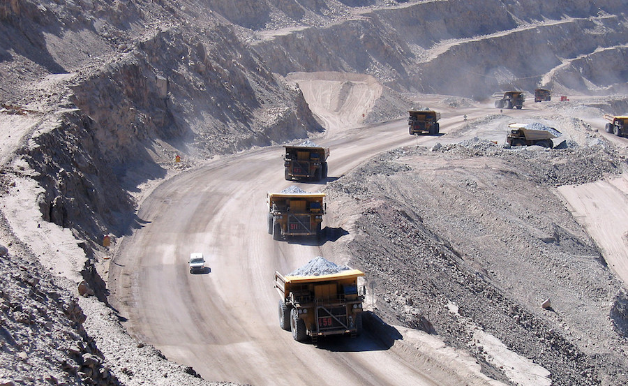 Mining trucks at Codelco's Chuquicamata copper mine in Chile. Haul truck fleets are more flexible than IPCC systems, but are expensive to operate.