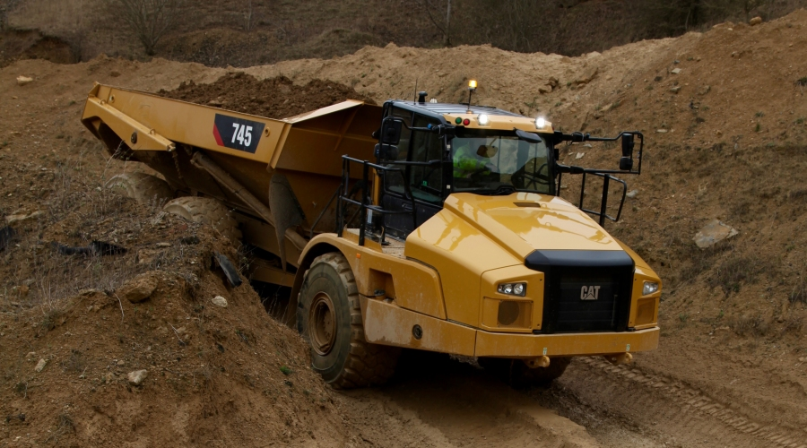 Cat 745 Articulated Truck on muddy road
