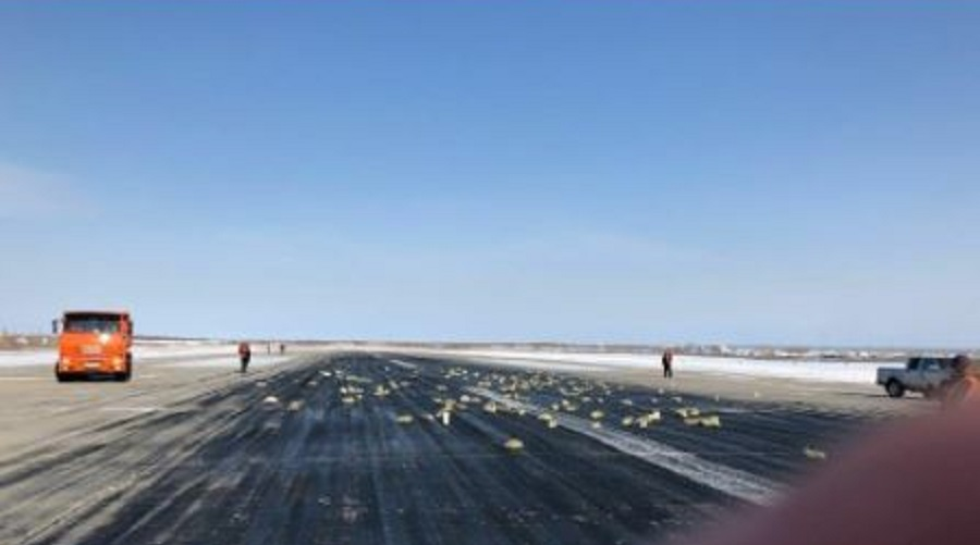 Gold spills on Russian runway after plane door glitch